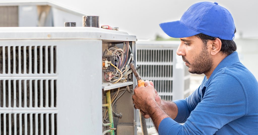 Contractor fixing AC unit